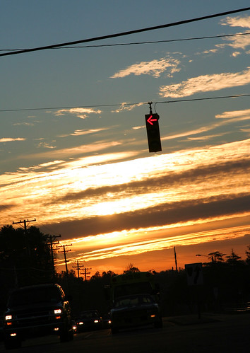 sunrise yelloworangeclouds stoplight headlights