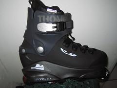 ski equipment(0.0), motorcycle boot(0.0), inline skates(1.0), inline skating(1.0), footwear(1.0), aggressive inline skating(1.0), roller skates(1.0), roller skating(1.0), boot(1.0), black(1.0),