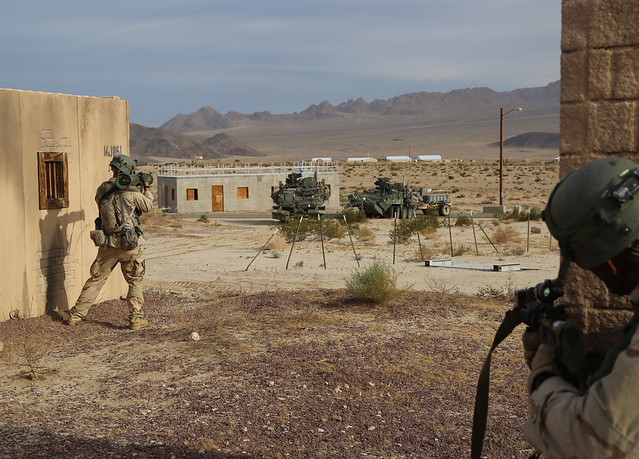 FORT IRWIN, Calif. -- U.S. Army Soldiers from the 11th Armored Cavalry Regiment play opposing forces against Soldiers of the 4th Battalion, 31st Infantry Regiment, 1st Stryker Brigade Combat Team, 1st Armored Division, during Decisive Action Rotation 15-0