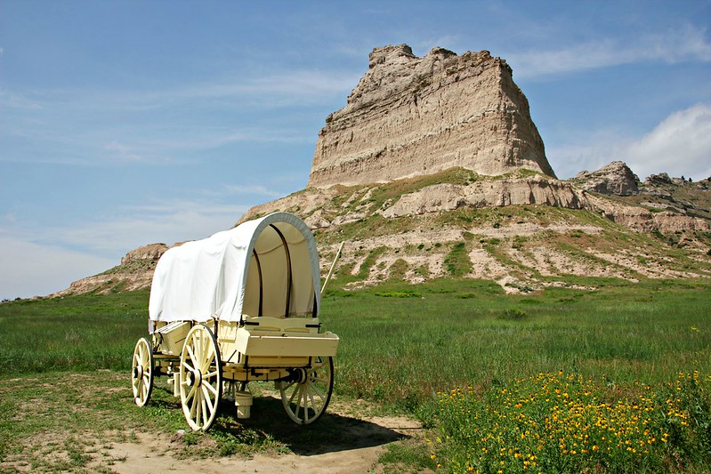 Scotts Bluff National Monument with an Oregon trail wagon