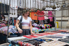 New York City Street Scenes - Young Woman Shopping a Jewelry Table at a Street Fair