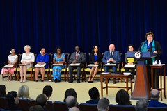 Kari Johnstone, Acting Director of the Office to Monitor and Combat Trafficking in Persons, delivers remarks at the 2015 Trafficking in Persons Report Ceremony at the U.S. Department of State in Washington, D.C., on July 27, 2015. From left to right, the 2015 Trafficking in Persons Report Heroes are Ms. Betty Pedraza Lozano of Colombia, Ms. Gita Miruskina of Latvia, Ms. Norotiana Ramboarivelo Jeannoda of Madagascar, Ms. Catherine Groenendijk-Nabukwasi of South Sudan, Mr. Moses Binoga of Uganda, Ms. Parosha Chandran of the United Kingdom, Mr. Tony Maddox of the United States, and Ms. Ameena Hasan of Iraq. [State Department photo/ Public Domain]