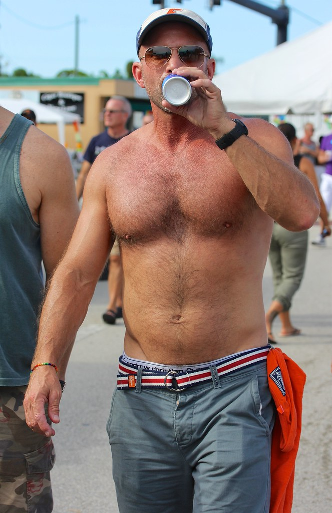 Man In Crowd With Beer Wilton Manors Stonewall Festival