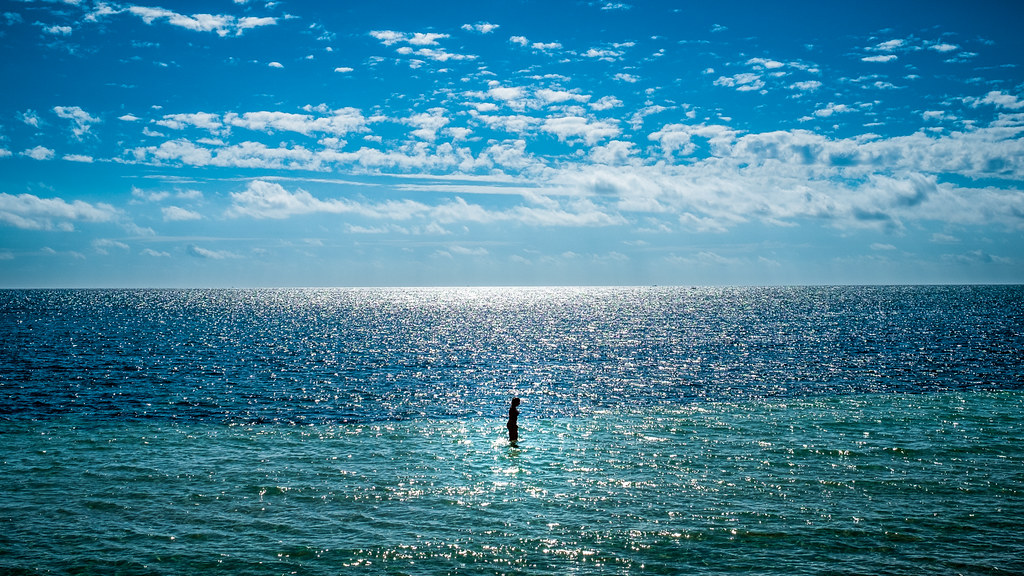A girl walking on water - Bahia Honda, Florida - Color street photography