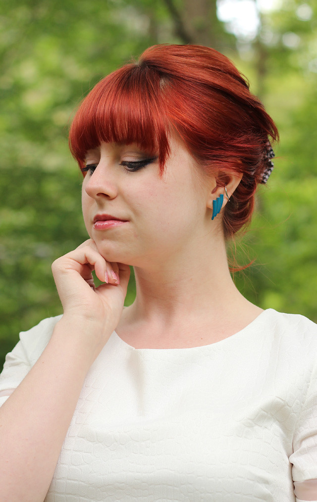 Red Bouffant, Smokey Eye Makeup, and a White Dress