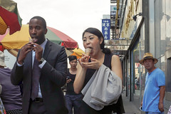 New York City Street Scenes - Business Man and Business Woman Eating Ice Cream Cones, Chinatown