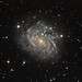 Hubble peeks at a spiral galaxy by NASA Goddard Photo and Video