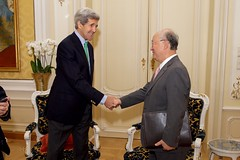 U.S. Secretary of State John Kerry shakes hands with International Atomic Energy Agency Director General Yukiya Amano on June 29, 2015, in Vienna, Austria, before a discussion amid the latest round of negotiations with Iranian officials about the future of their country's nuclear program. [State Department Photo/Public Domain]