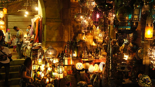 A Lady checking the lamps in Bab El-Ghuri