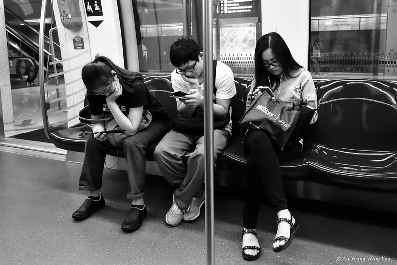 Train Commuters And Their Phones