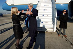 U.S. Secretary of State John Kerry prepares to embrace U.S. Ambassador to France Jane Hartley after he arrived at Paris–Le Bourget Airport in Paris, France, on December 8, 2016, for a series of meetings, and to receive the Legion of Honor award from French Foreign Minister Jean-Marc Ayrault. [State Department photo/ Public Domain]