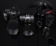 binoculars(0.0), wheel(0.0), cameras & optics(1.0), digital camera(1.0), camera(1.0), single lens reflex camera(1.0), optical instrument(1.0), camera lens(1.0), black(1.0), reflex camera(1.0),