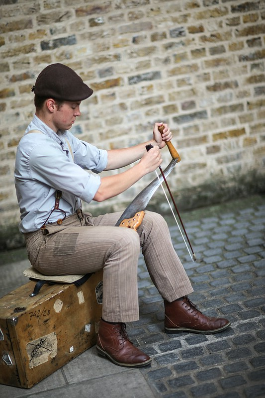 Street musician playing a saw