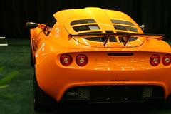 lotus elise(0.0), automobile(1.0), lotus(1.0), automotive exterior(1.0), vehicle(1.0), performance car(1.0), automotive design(1.0), lotus exige(1.0), auto show(1.0), land vehicle(1.0), luxury vehicle(1.0), supercar(1.0), sports car(1.0),