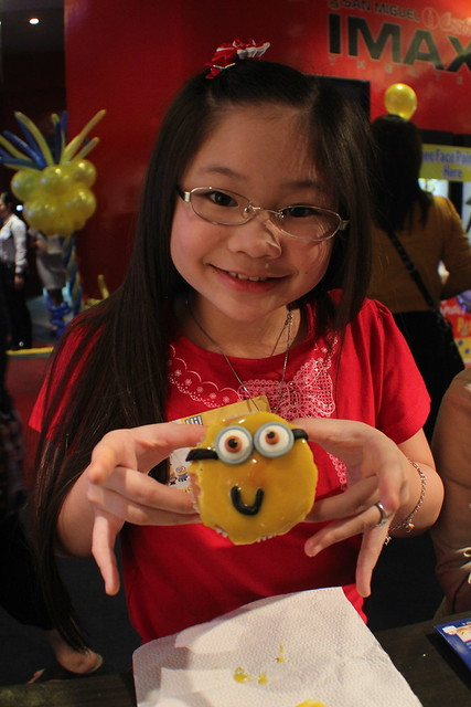 Isabel Frial makes her own minion mamon at the Monde Nissin booth