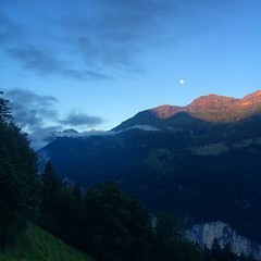 Sunrise and full moon in the mountains