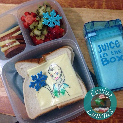 Loving my dodgey #Elsa in Miss M's @easylunchboxes for today… with pepperoni, cheese & crackers; snowflake strawberry & kiwi salad and milk in her #juiceinthebox from @boardwalkimports ❄️👀