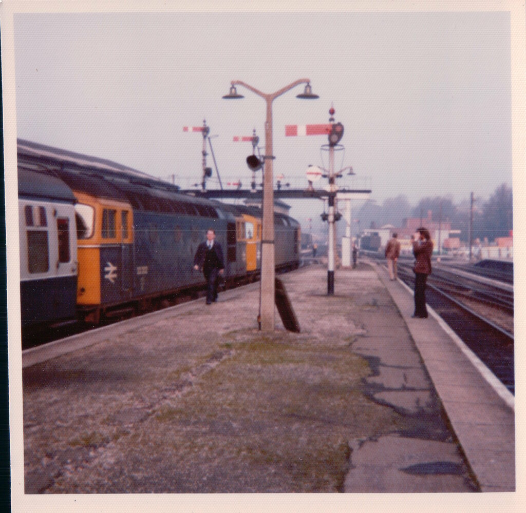 A pair of 33s on a Awayaday special from the Southern Region prepare to run around the coaches and continue their journey to Plymouth. 1970s.