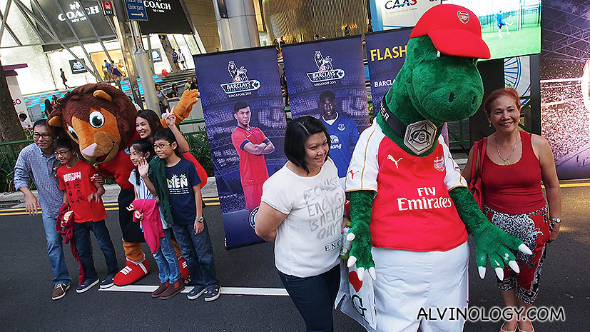 Take pictures with football mascots