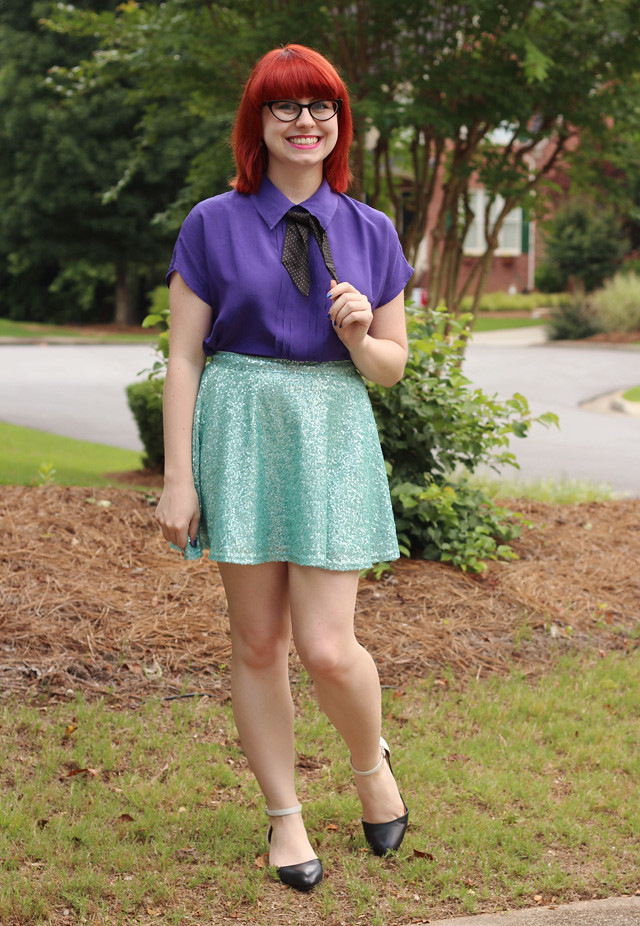 Purple Silk Blouse, Polka Dot Tie, Sequined Green Skater Skirt and Cat Eye Glasses