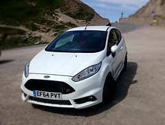race car(0.0), world rally car(0.0), automobile(1.0), supermini(1.0), vehicle(1.0), automotive design(1.0), city car(1.0), bumper(1.0), ford(1.0), ford fiesta(1.0), land vehicle(1.0),