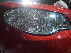 automotive tail & brake light(0.0), wheel(0.0), rim(0.0), grille(0.0), automobile(1.0), automotive exterior(1.0), vehicle(1.0), automotive lighting(1.0), light(1.0), bumper(1.0), headlamp(1.0), land vehicle(1.0),