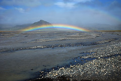 Double rainbow over icelandic landscape