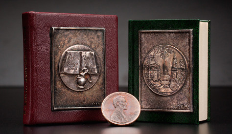 Miniature coin book with medal