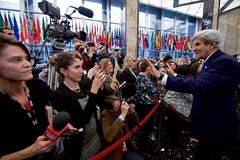 U.S. Secretary of State John Kerry acknowledges members of the Department's press corps as he departs the main lobby of the Department's Harry S. Truman Building after delivering farewell remarks to employees on January 19, 2017. [State Department photo/ Public Domain]