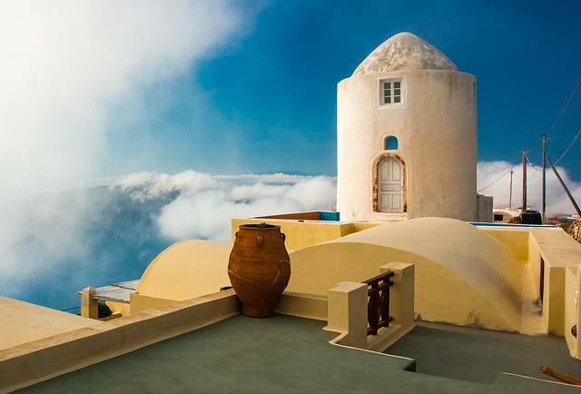 Santorini - A former windmill in the clouds.