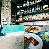 """Loved the vibe of @bacomercat. I knew I was going to have a fantastic meal: fried squid, Caesar brussel sprouts, chicken """"ribs"""" with cucumber salad, grapefruit sweet and sour drinking vinegar. by actionhero"""