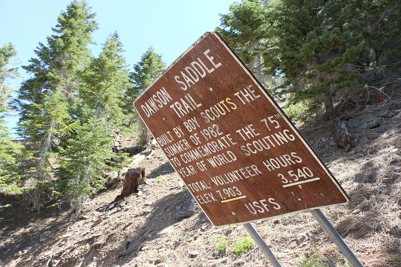 The Dawson Saddle Trail Sign is falling down.