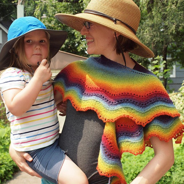 We're both wearing rainbows! (Though hers are a bit more appropriate for today's weather!)