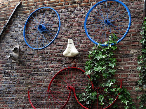 Bicycle Art on a Dutch Brick Wall in Amsterdam, Holland