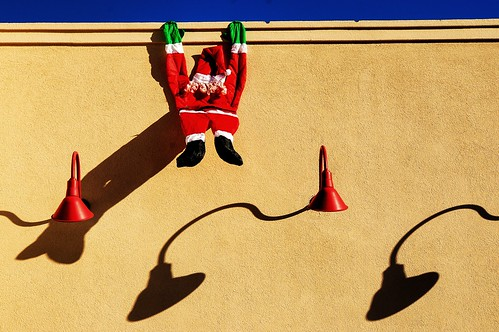 santa stjoe saintjoseph christmas hanging stucco sunshine shadows lights sony nex6 alphanex6 winter missouri midwest town western roadtrip old forgotten fading memories roadside sunset 2012 fotoedge bobtravaglione classic santaclause sled reindeers dasher rudolf explore