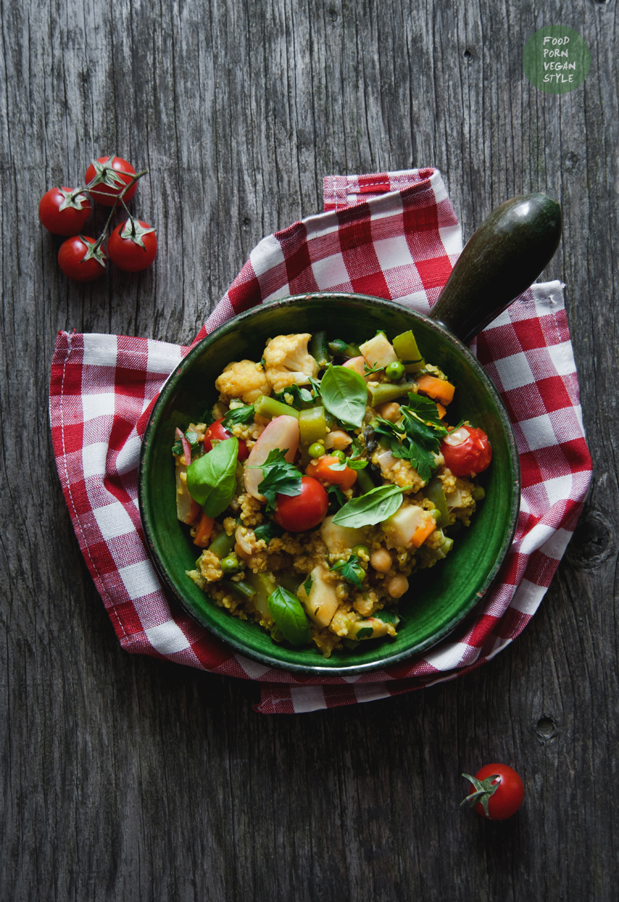 Vegan paella with summer vegetables and millet