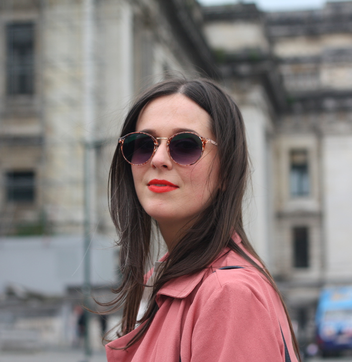tortoise sunglasses, orange lipstick, pink trenchcoat