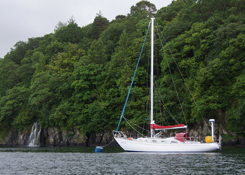 Raasay on a visitors' mooring in Tobermory, with private waterfall.