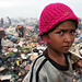 Pink hat - the garbage dump in Phnom Penh, Cambodia by Maciej Dakowicz