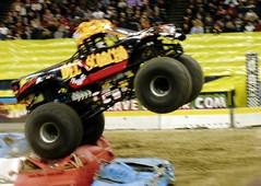 racing(0.0), dirt track racing(0.0), off road racing(0.0), sprint car racing(0.0), auto racing(1.0), automobile(1.0), wheel(1.0), vehicle(1.0), sports(1.0), race(1.0), motorsport(1.0), off-roading(1.0), monster truck(1.0), race track(1.0),