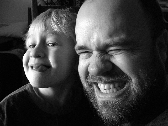 Father and son making faces