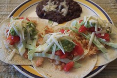 tostada(0.0), vegetarian food(0.0), falafel(0.0), meal(1.0), taquito(1.0), flatbread(1.0), taco(1.0), tortilla(1.0), meat(1.0), produce(1.0), food(1.0), dish(1.0), cuisine(1.0),