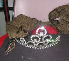 clothing(0.0), hat(0.0), cap(0.0), jewellery(1.0), headpiece(1.0), tiara(1.0), headgear(1.0),