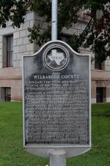 Photo of Josiah P. Wilbarger and Mathias Wilbarger black plaque
