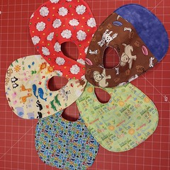 Five bibs for the hubster's friend, finished and ready to gift! Free pattern from @joann_stores. #sewing #bibs