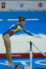 floor gymnastics(0.0), modern pentathlon(0.0), athletics(0.0), jumping(0.0), pole vault(0.0), swimmer(0.0), heptathlon(0.0), rings(0.0), sports(1.0), gymnastics(1.0), gymnast(1.0), artistic gymnastics(1.0), uneven bars(1.0), athlete(1.0),