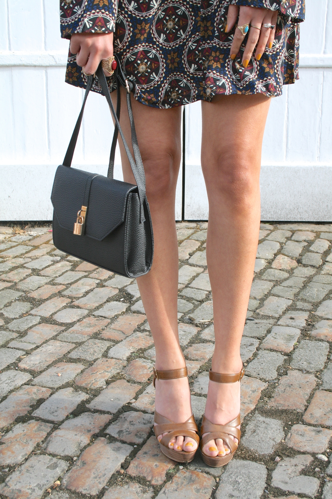 legs and tan wedges