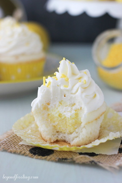 Lemon Cream Pie cupcakes. Vanilla cupcake with lemon mousse and cream cheese whipped cream. You won't be able to stop after just one bite!
