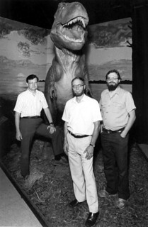 Florida State researchers stand in front of a dinosaur exhibit - Tallahassee