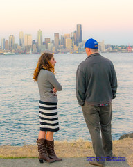 A Couple Take In Sunset Falling Upon the Seattle Skyline